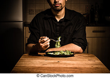 Man at home having dinner