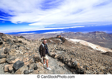 Man at mountain landscape near volcano Teide