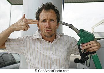 man at petrol pump - man shooting himself over crazy petrol...