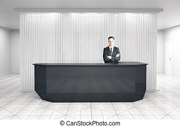 Man at reception desk