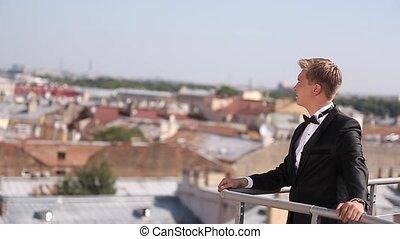 Man at terrace at sunny day