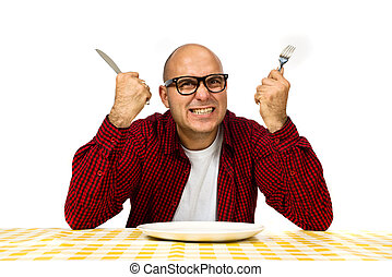 Man at the dinner table - Young adult bold man sitting at...