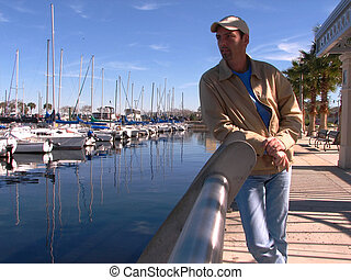 Man at the Pier - Shot of a mature young man, watching from...