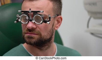 Man at the reception of an ophthalmologist. Eye examination...