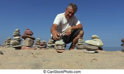 Man at the stone equilibrium pyramids
