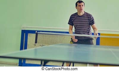 man athlete playing sport table tennis slow motion video backhand
