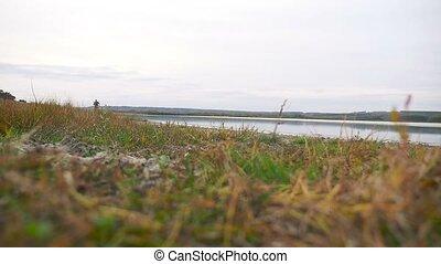 man athlete sport runs runner on nature near a lake healthy...