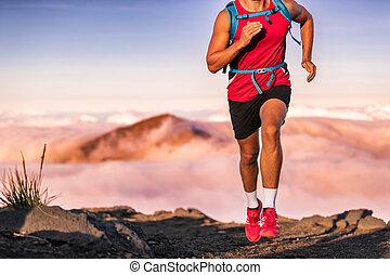 Man athlete trail running in the mountains landscape. Runner athlete training