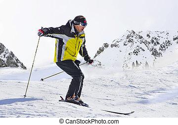 man athletes skiing in mountains