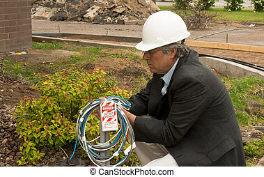 man attaching lockout tag - construction foreman attaching a...