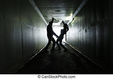 Man attacks a woman with a knife in a dark tunnel