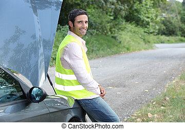 Man awaiting roadside assistance