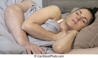 Man awaken by his partner snoring and trying to stop it