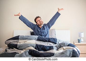 Man awakening feeling happy in the morning