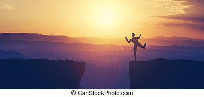 Man balancing on the edge of a cliff.