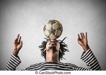 Man balancing with ball
