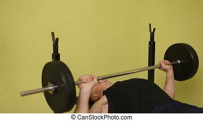 man barbell training