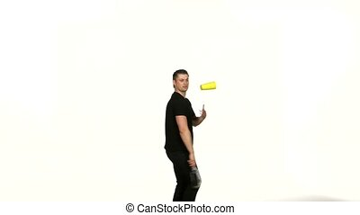 man bartender does a trick with a shaker on white