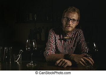 Man bartender with wine glass
