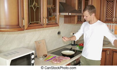 Man Beats Meat By Kitchen Hammer, funny guy dancing and preparing food