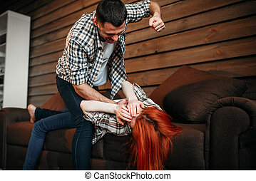 Man beats woman, domestic violence, quarrel