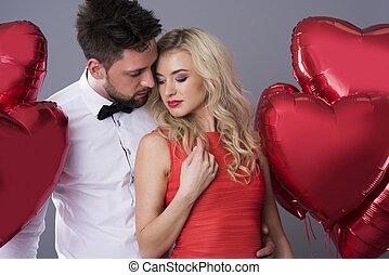Man behind his beloved girlfriend