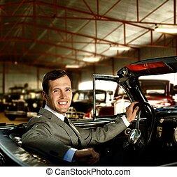 Man behind wheel in a retro car