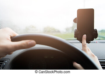 Man behind wheel with smartphone