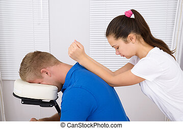 Man Being Massaged By A Physiotherapist