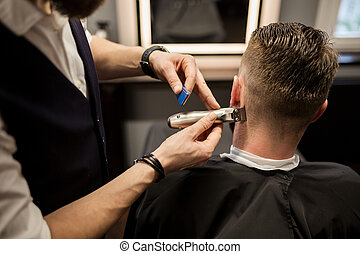 Man being trimmed at barber shop