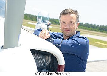 man beside a propeller