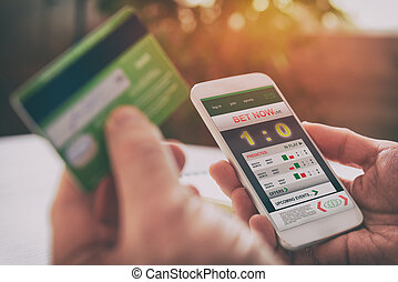Man betting on sports with smartphone