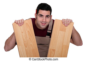 Man between two lengths of parquet