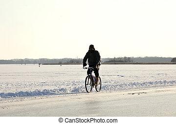Man biking on lake