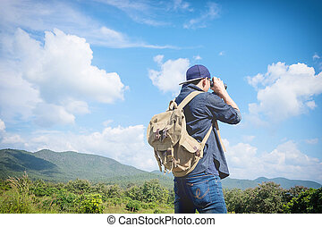 Man Binoculars Looking Mountain Cloudscape Traveling Concept