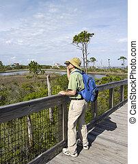 Man Birdwatching at Florida State Park