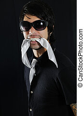 Man biting his tie