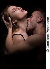 Man biting woman's neck - Hot foreplay - passionate man...