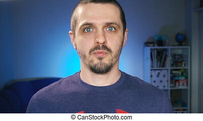 Man blogger looking in camera and talking to his audience