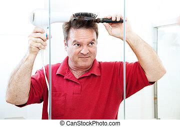 Man Blow Dries Hair
