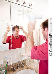 Man Blow Drying Hair in Bathroom