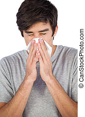 Man blowing his nose on a white background