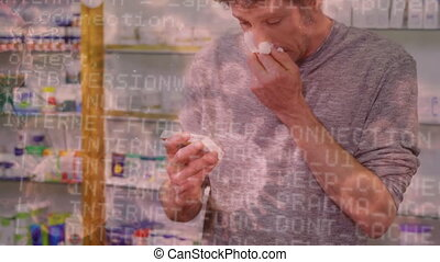 Man blowing nose and Covid-19 spreading in background - ...