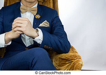 man blue suit sitting on cozy sofa