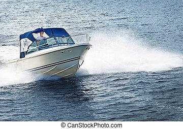 Man boating on lake - Man piloting motorboat on lake in...
