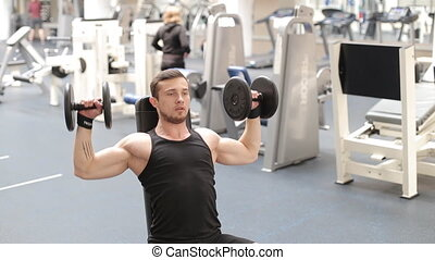 Man bodybuilder execute exercise with dumbbells in gym.