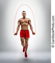 man bodybuilder jumping with jump rope