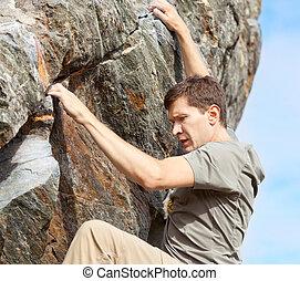 man bouldering
