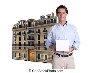 Man, box and Parisian building