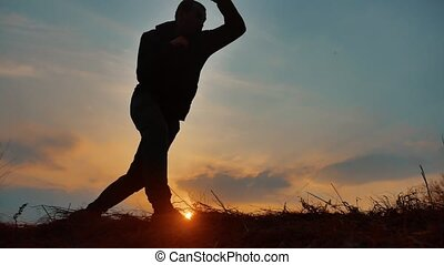 man boxer boxing on nature silhouette sunset sunlight....